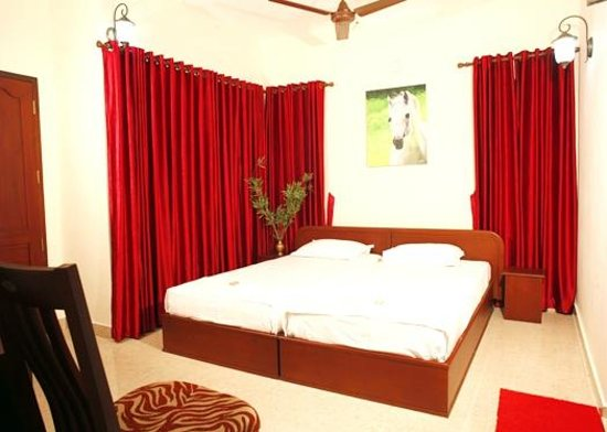 Homested Cochin: A\C Room under the shade of trees with balcony