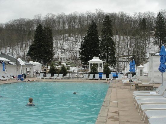 The Omni Homestead Resort: Outdoor pool with snow-capped mountain background