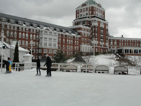The Omni Homestead Resort: Ice skating rink with snow-capped around