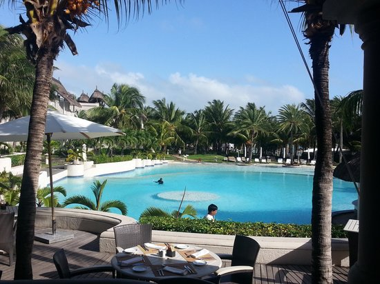 LUX* Belle Mare: the3 swimming pool . morning early at breakfast time