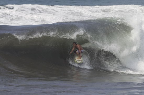 Komune Resort, Keramas Beach Bali: Surfing in front of the pool