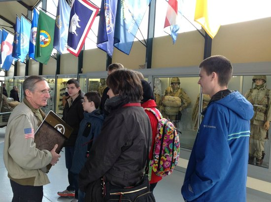 D-Day Battle Tours : Ellwood gives a tour of the paratrooper museum in St. Mere Eglise