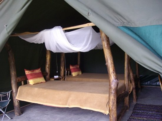 Ol Mesera Tented Camp: authentic wooden bed frames in one of the tent