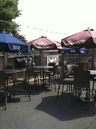 Village Tavern: inviting outdoor patio/bar