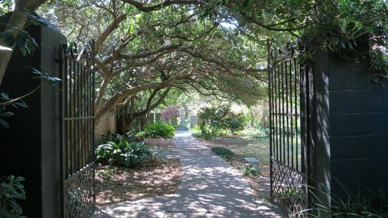 Charleston, SC: One of the decorative iron gates that give passage onto the walk.