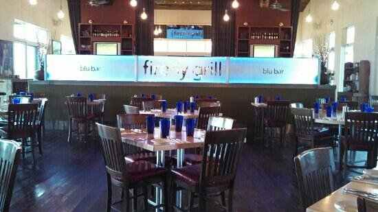 firefly grill interior. full bar with twin flat screen tvs