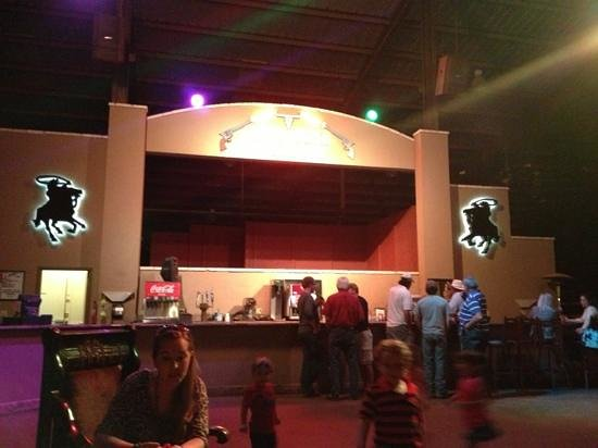 Crossfire Steakhouse & Cantina: bar area has stage for bands and to east overlooks the pool .