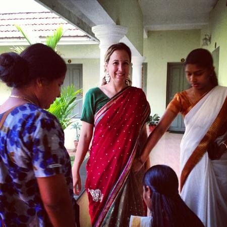Pattarumadom Ayurveda: dressing me in a sari so I could join them at temple. so sweet the women are here. like sisters!
