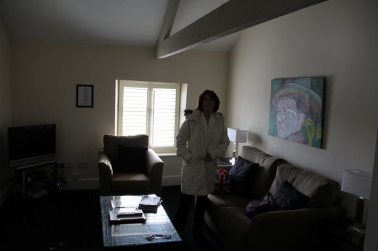 The Bear Hotel: Christine touring the living room of the flat.