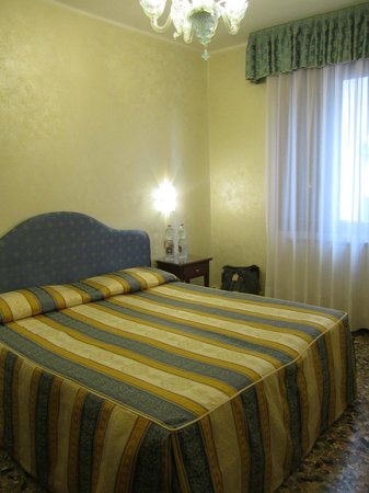 Hotel Hesperia: The bed and Venetian chandelier in my room.