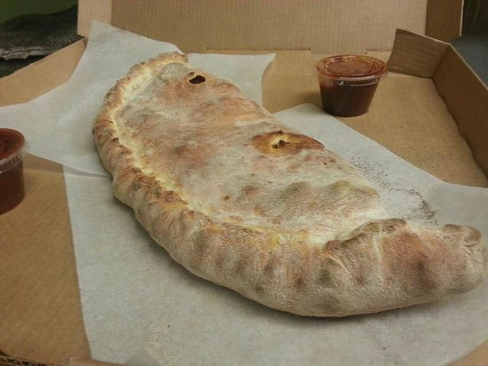 Mezzys Pizzeria: Large Calzone served with sauce on the side