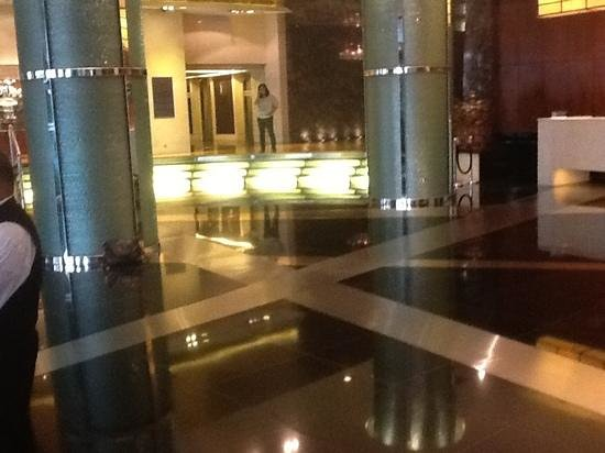 New World Manila Bay Hotel: some people lean on posts like i did others stand around stairs.  no lounge it really amazed me