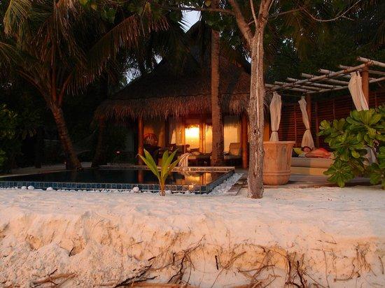 Taj Exotica Resort & Spa: reflection of sunset on the room