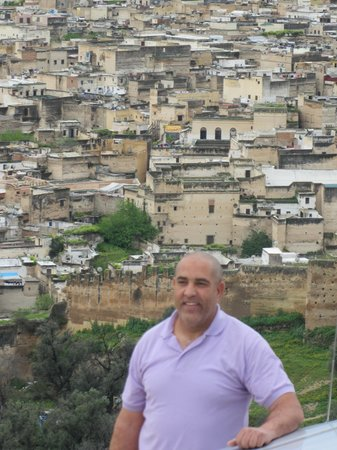 Travel Exploration Morocco Private Tours: Tahar with Fes in the background