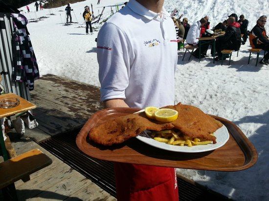 Xxl Format Schnitzel Served At The Table After Ordering At The