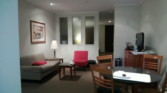 Mantra on Little Bourke: Double Queen room Lounge with divider between lounge and bedroom