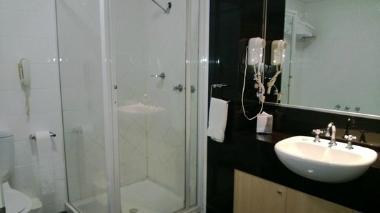Mantra on Little Bourke: Double Queen room bathroom which includes a bath