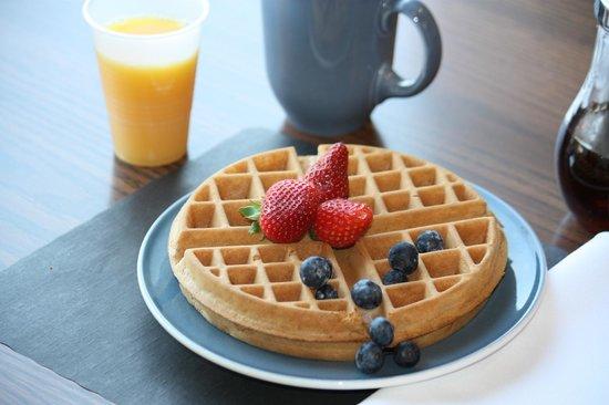 Comfort Inn: Free hot breakfast buffet featuring fresh fruit, toast, danish, juice...and your choice of origi