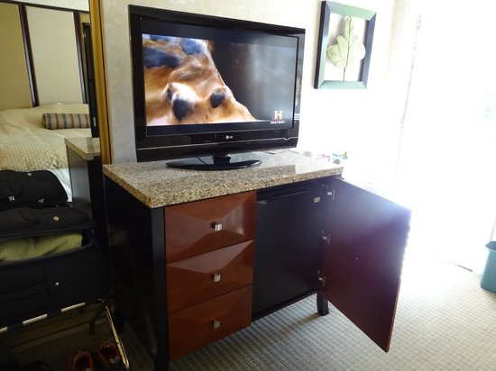 Best Western Plus Corte Madera Inn: TV with micro fridge in cabinet beneath