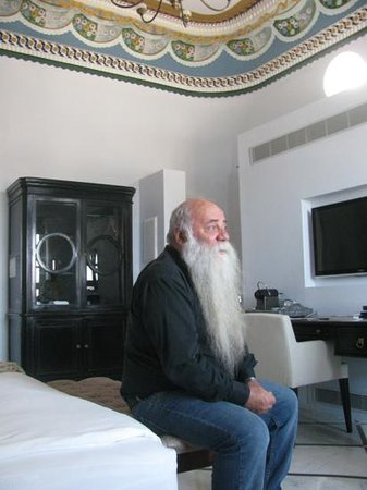Efendi Hotel owner, Uri, in one of the guest rooms
