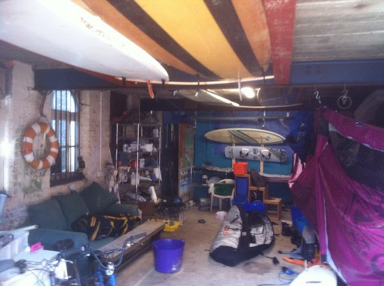 Harbourside House Surf Lodge: The Watersports centre in the boatshed