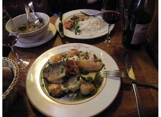 Le Bistrot d'Henri : Two fish main course in the foreground and curry in the background