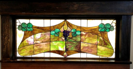 Bee & Thistle Guest House: Original period pieces like this 100 year old stained glass are throughout the home.