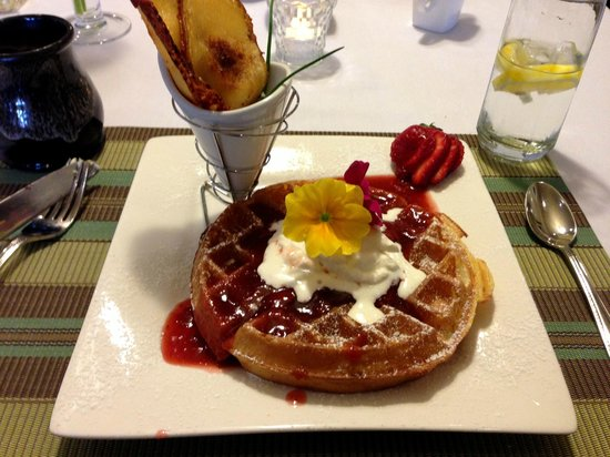 Bee & Thistle Guest House: Lemon Belgian Waffles with Strawberry Rhubarb sauce, whipped cream, and maple syrup