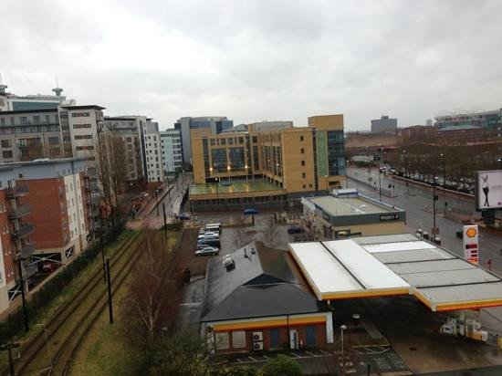 ibis budget Manchester Salford Quays: View from the room, tram stop to the left. United football ground on the right.