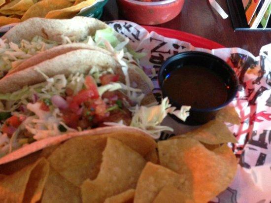 Tijuana Flats: savory grilled mahi mahi fish tacos topped with super fresh cabbage