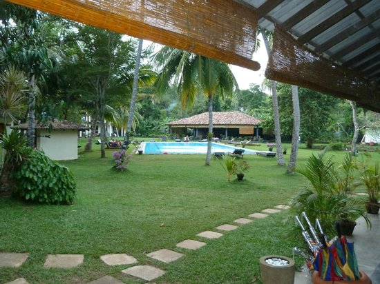 Talalla Retreat: View of the pool and main dining area, common area from room