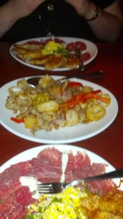 Fleming's Prime Steakhouse & Wine Bar: Beef Tenderloin Carpaccio & Calamari