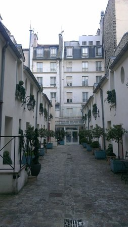 Unic Hotel: view from back end of the courtyard towards the rear of the hotel.