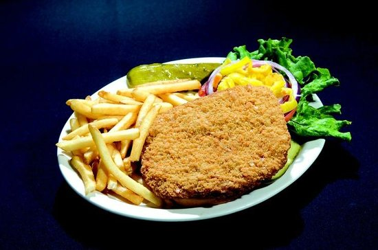 Arni's Restaurant: Our delicious pork tenderloin served with fries and all the toppings you need!