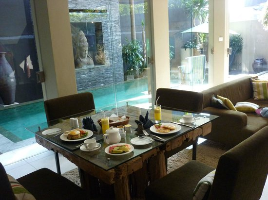 Cicada Luxury Townhouses: View at breakfast - junior suite lap pool and waterfall