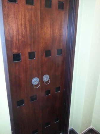 Pradha Villas: Door leading to powder room