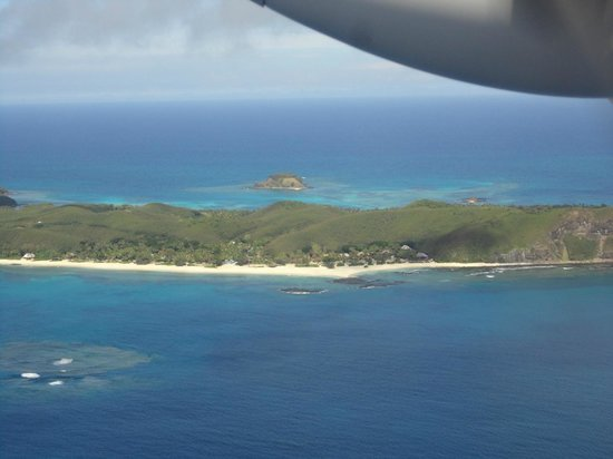 Yasawa Island Resort and Spa: the resort and the beach by the airplane
