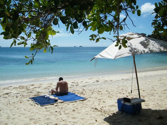 Yasawa Island Resort and Spa: Paradise Beach - our umbrella and the necessary for the day