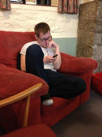 YHA Dartmoor: Lukas listening a music