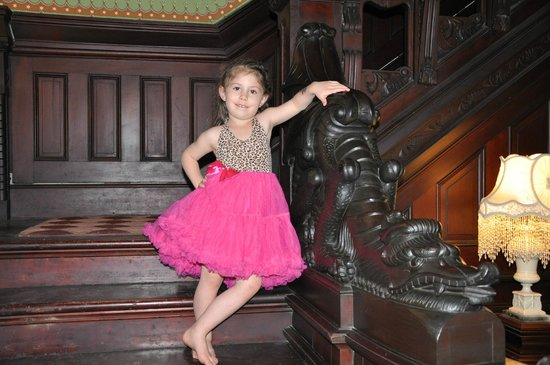 Shakespeare Chateau Bed & Breakfast: My granddaughter by the dragon stairway