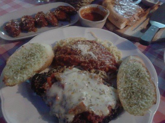 Pizza n Pasta: Chicken Parmesan w/ spaghetti & Chicken wings in background