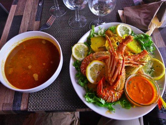 bouillabaisse a la marseille: the bouillon on left, seafood and