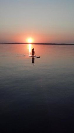 Sunset Beach Resort : Stand up paddle boarding at Sunset.
