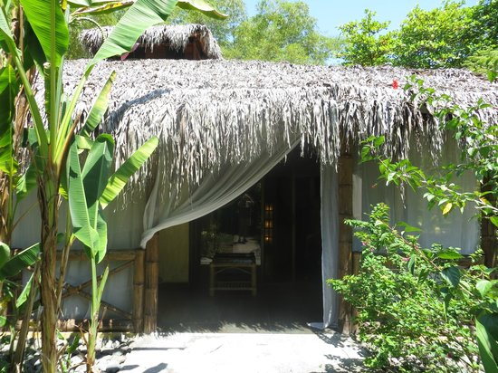 Clandestino Beach Resort: Entrance to your own hut (also has sliding doors beyond.)