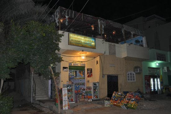 Nile Flowers: Street view of restaurant (entrance are stairs on left)