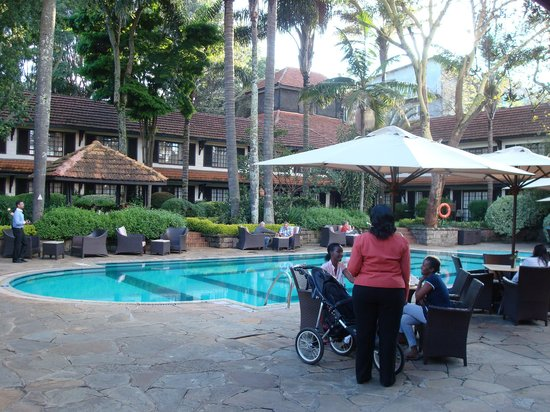 Restaurant by the swimming pool picture of southern sun for Pool garden restaurant nairobi