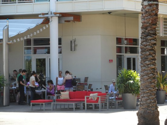Michael's Genuine Food & Drink: Looking at outside dining of restaurant from park area