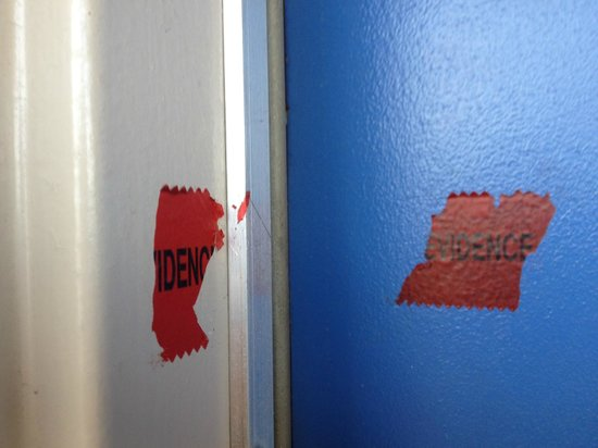 Motel 6 Miles City: Evidence tape on the door to the room