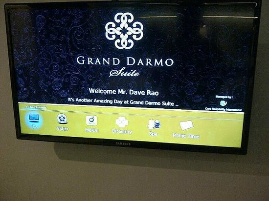 Grand Darmo Suite by AMITHYA : Personalised welcome message on TV screen in the room.