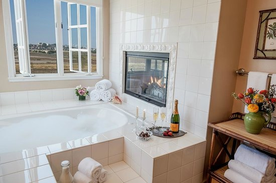 Inn at Playa Del Rey: The Grand View Suite Bath with oversized jacuzzi tub, fireplace and view of the Nature Preserve